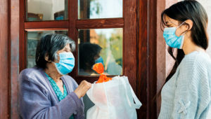 enliven-volunteer-helping-elderly